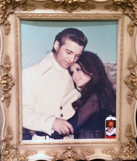 """Beautiful framed portrait of a young Waylon Jennings with the love of his life, Jessi Colter. Portrait by famed country music photographer Hope Powell. Circa 1969. 21"""" x 25""""."""