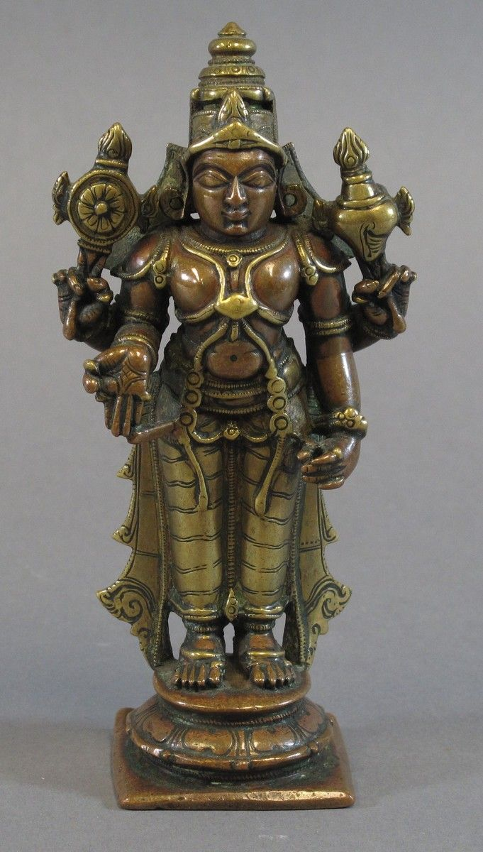 A GANGAJUMNA FIGURE OF VISHNU South India, 18th century bronze and brass, standing on a lotus t