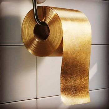 gold flake toilet paper. gold luxury is toilet paper. australian company paper man produced a roll made from flakes through the roll. flake l