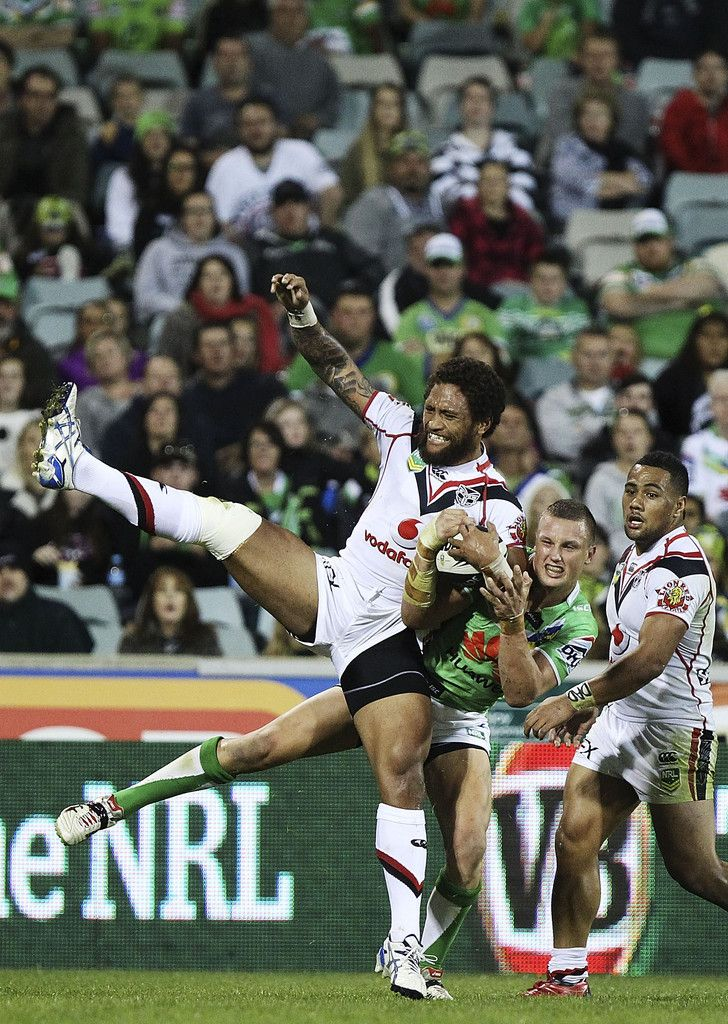 Manu Vatuvei of the Warriors and Jack Wighton of the Raiders contest a high ball during the round six NRL match between the Canberra Raiders and the New Zealand Warriors at Canberra Stadium on April 13, 2013 in Canberra, Australia. #Rugby #NRL