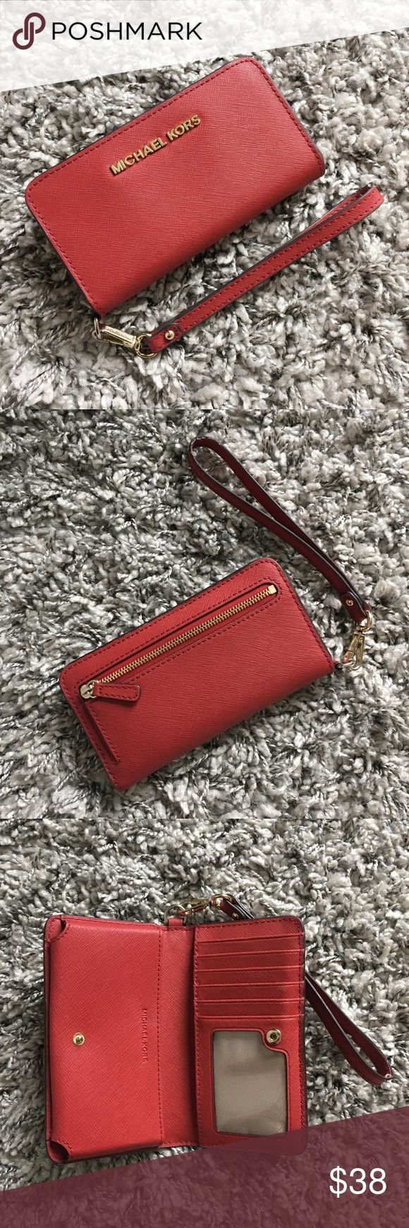Michael Kors tech wallet / phone wristlet (red) Michael Kors red tech wallet. Fits iPhone 6/6s, but not 6/6s plus. Perfect for having your phone and credit cards all in one place. Has place for cash and has a zipper on the back for coins. Super convenient when running errands or just everyday use as a wallet! Signs of wear on the credit card slots and wear on the trim of the wrist strap, as shown in the last two pictures. Michael Kors Bags Wallets