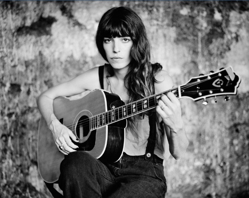Lou Douillon playing guitar. She has this photo hanging in her room. It inspires her to keep playing the guitar.