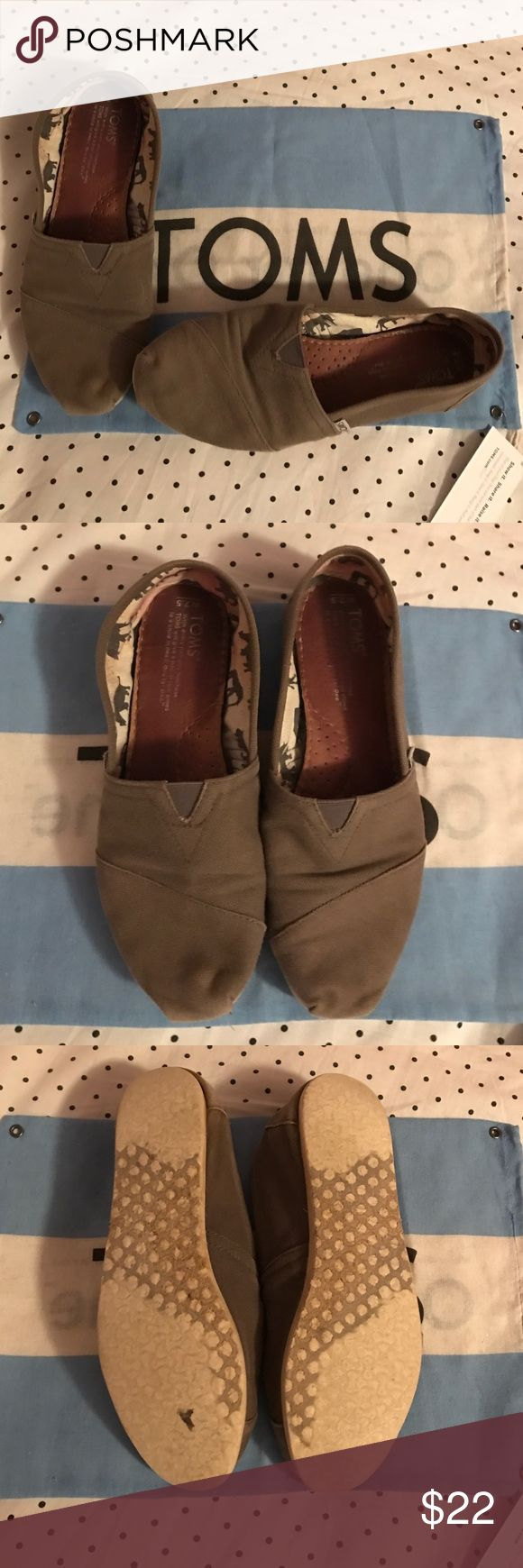 Gray Toms Previously worn, but still in good condition. I always wore socks with them, so there is some light pink staining on the inner heels of shoe from socks. No tears, apart from a small beginning tear on the heel. TOMS Shoes Flats & Loafers