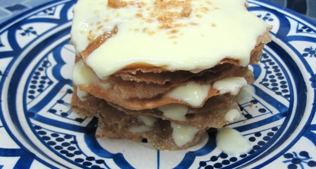 Ktefa - Crispy Moroccan Pastry Layered with Custard Sauce and Almonds