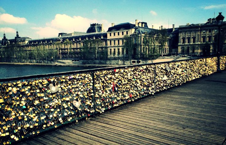 Love Lock Bridge With The Louvre In The Background