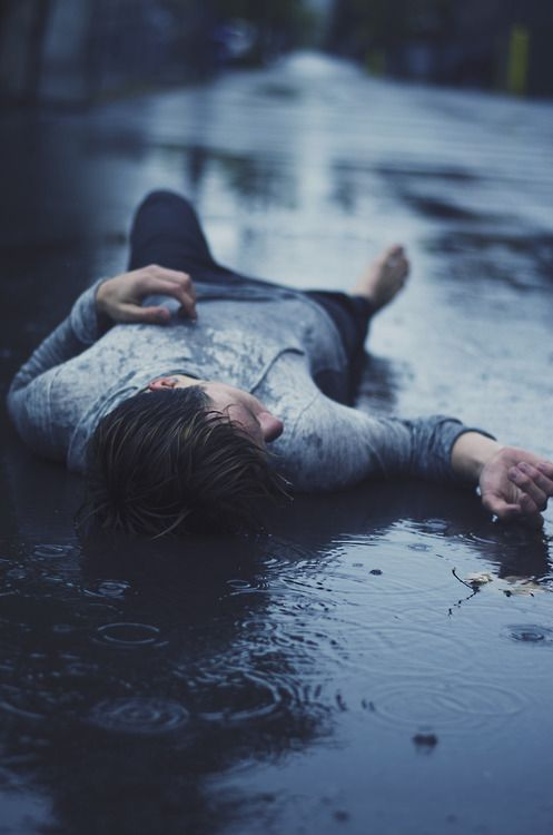 """(Open rp, be him please?) I walk around, alone. It's getting dark, and it's raining hard. I see something, or someone, laying in the middle of the street. I cautiously approach, and I see my crush laying there, completely unconscious. """"Oh gosh.."""" I say as I kneel down beside him, and I gently shake his shoulder. He doesn't move. This is really bad. I gently shake his shoulder again and he groans but doesn't move."""