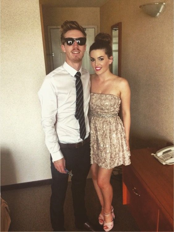 Maid of honour Britt McKillip and her date at Carly McKillip and Darren Savard's wedding on May 9, 2015