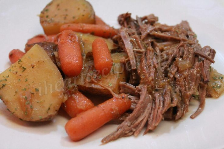 Easy Pot Roast Recipe with carrots, onions, and potatoes. I used a really cheap cut of beef and cooked it low and slow in my dutch oven. You can also cook the roast in roaster.