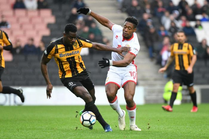 Chuks Aneke battles for the ball during MK Dons' FA Cup clash with Maidstone United (Pictures: Jane Russell)