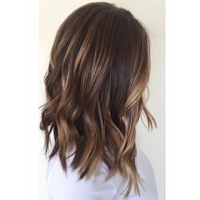 Took her blonde ombré to a textured lob and created a caramel chocolate balayage