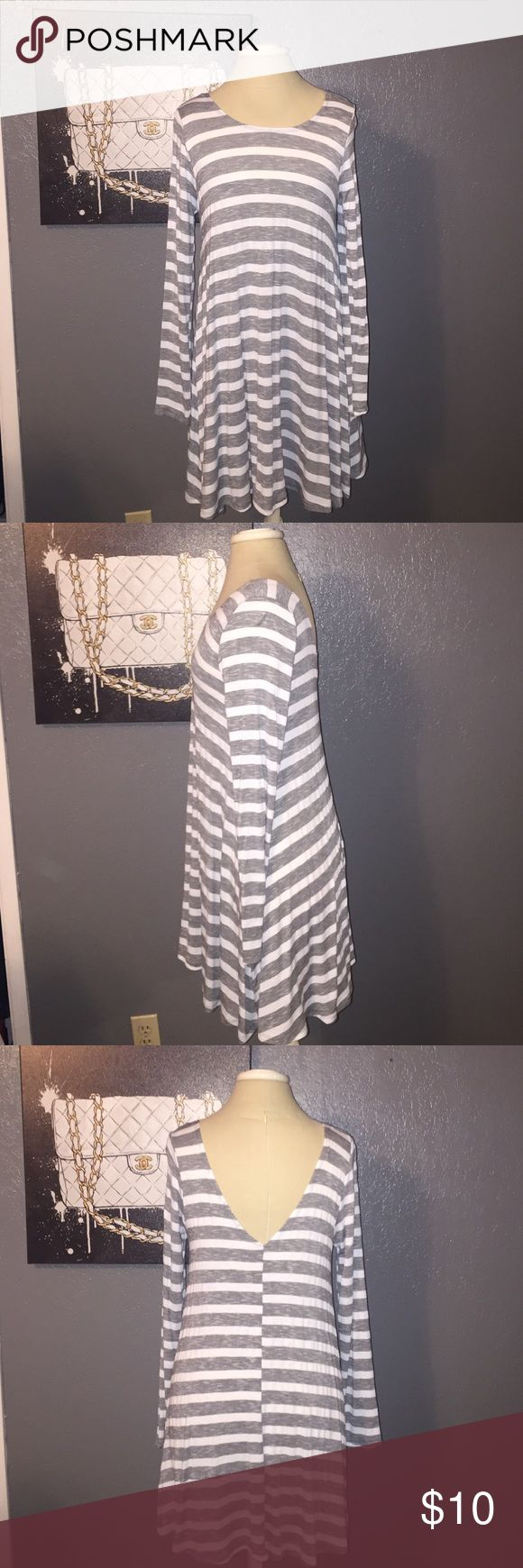 Striped Long Sleeve Flowy Dress White and grey stripes. Long sleeve. Crew neckline with plunging v in the back. Size medium. Relaxed fit. Unlined. Purchased at Wet Seal. Worn once. Wet Seal Dresses Long Sleeve