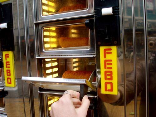 We call this: Uit De Muur Eten (Eating From The Wall). This vending machine way of eating snacks was invented at snack bar FeBo (1960, Amsterdam). #greetingsfromnl