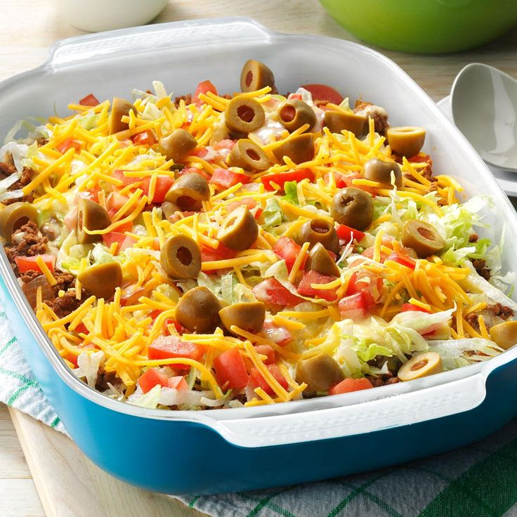 Haystack Supper Recipe -Served as the main dish at our family reunion buffet, this flavorful layered taco-style dish is a crowd-pleaser. Folks are pleasantly surprised to find a rice layer, and everyone enjoys the creamy cheese sauce. —Jill Steiner, Hancock, Minnesota
