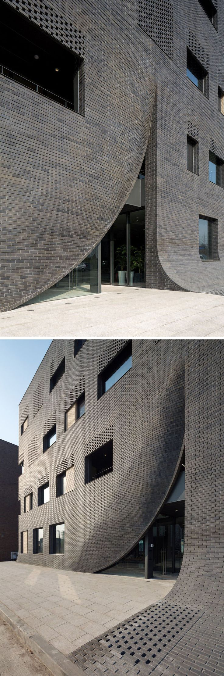 This black brick building has a 'crack' in it to reveal the entrance.