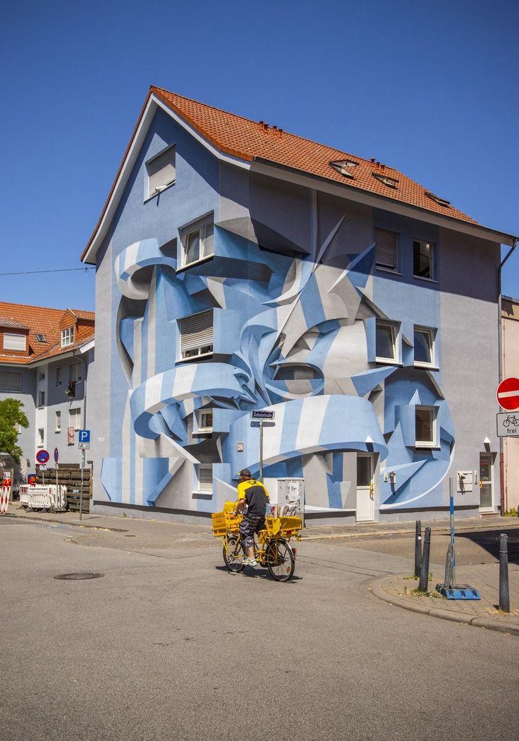 Ce street artiste crée des illusions d'optique hallucinantes en repeignant les murs de bâtiments