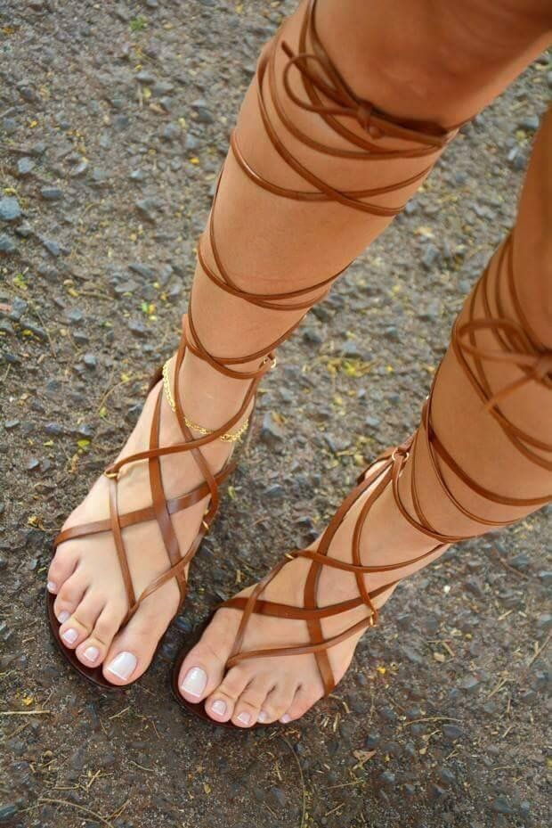 she has pretty feet & toes! love those strappy sandals!