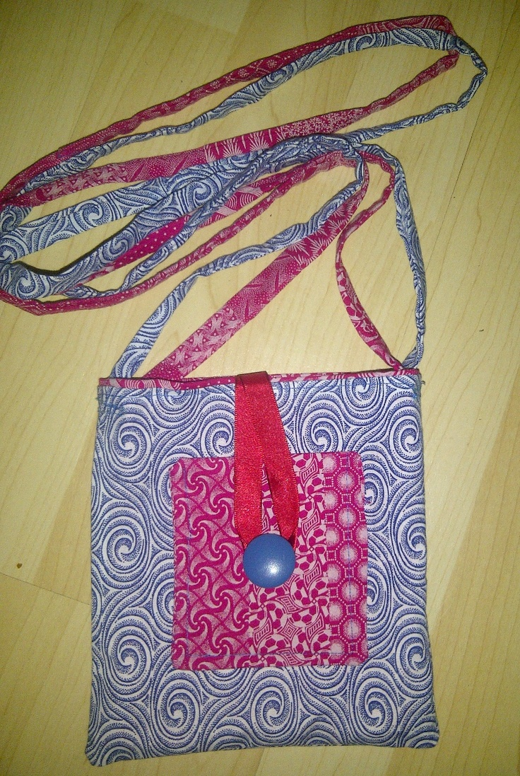 Smaller sling bag made from 100% cotton Shweshwe - product of the Eastern Cape, South Africa