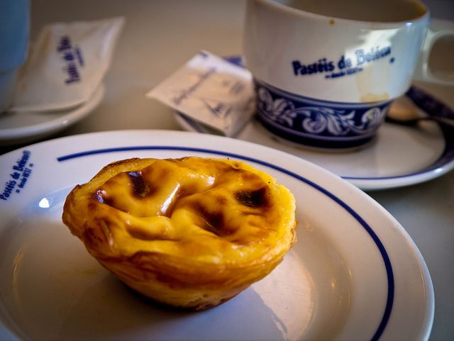 Pastel de Belém (Lisbon, Portugal). 'The Pastel de Belém is a small baked tart with a flaky pastry shell filled with a sweet, creamy egg-based custard and sometimes sprinkled with cinnamon.' http://www.lonelyplanet.com/portugal/lisbon/sights/village/belem