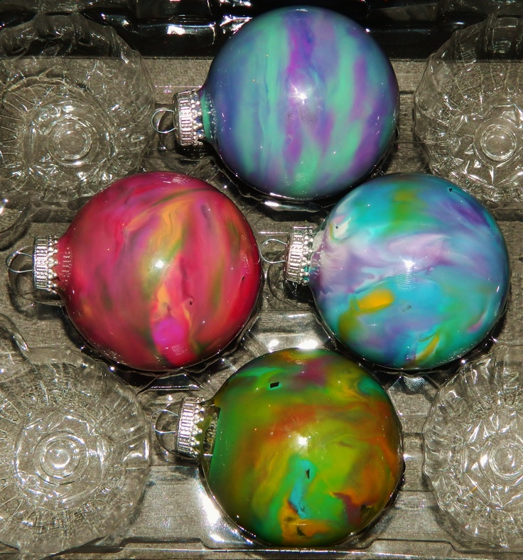 Melted crayon chips inside a clear glass Christmas ornament, using a hair blow dryer.  Super Cute!!