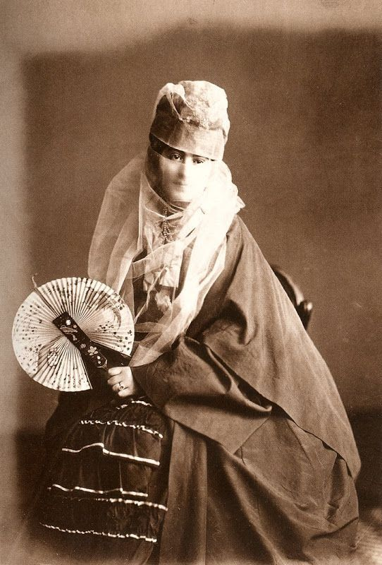 Veiled ottoman woman in street dress. Old studio photo. Late ottoman Empire. End of the 19th century