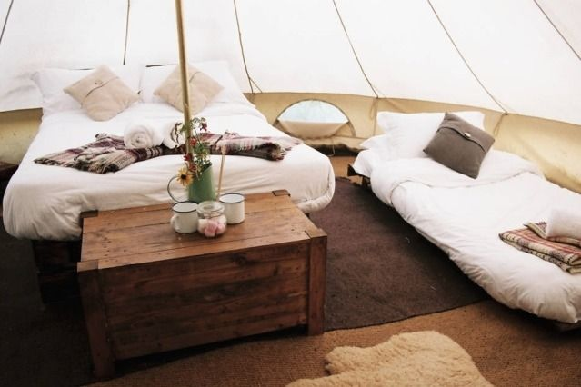 (Airbnb) Quirky Places To Stay With The Kids In The UK: Glamping near Bath, Wiltshire (Explore Bath and its beautiful surrounding countryside from this stylish bell tent, which features a wood burner, plus a  games room and indoor heated pool for guests. You and your family can get back to nature with all the comforts of a luxury stay in the beautiful home from home. The glamping tent provides a rustic interior, cosy beds for four and a sheepskin rug for a warm atmosphere. From £98 per…