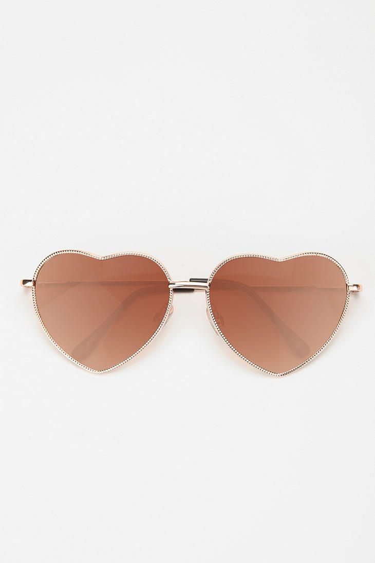 tried on these heart-shaped sunglasses at Urban Outfitters the other day... i totally loved almost famous :)