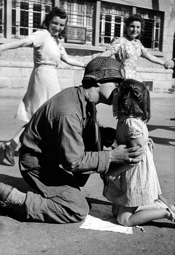 The photo of a US Army soldier embracing a young French girl, while others are dancing in the background, is one of the most famous images of war photographer Tony Vaccaro.