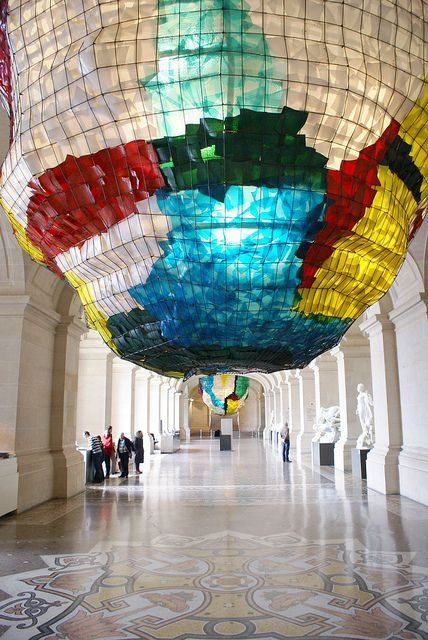 Two giant glass-and-steel chandeliers at the Palais des Beaux-Arts in Lille, France. desinged by Gaetano Pesce.