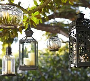 I want a corner of the patio to have a bunch of these different hanging lanterns.