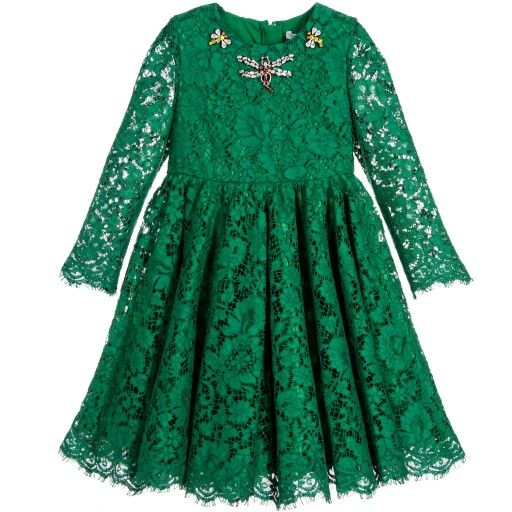 Girls green and ivory jacquard dress designed by Dolce & Gabbana, featuring the designer's beautiful banana leaf printed silk and cotton blend, inspired by the Palermo Botanical Garden. This gorgeous dress has a high waistline with a full, gathered skirt which has an inverted pleat at the front.The two patch pockets have fabulous dragonfly appliqués, encrusted with red, yellow and white jewels. Would look lovely with flat green pumps.