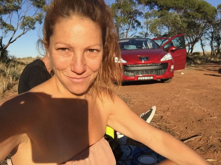 Joanna in the middle of nowhere, some where between NSW and Victoria and South Australia. Stopping to draw a tree. 2017