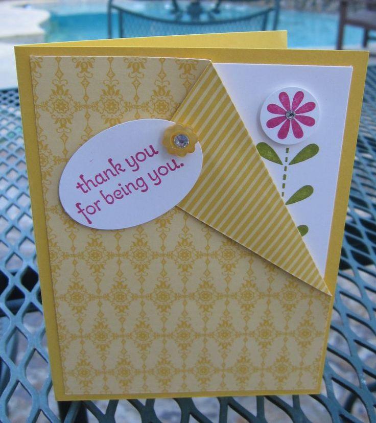 Handmade card with a neat fold revealing a flower. Could also put a Cricut animal peeking through.