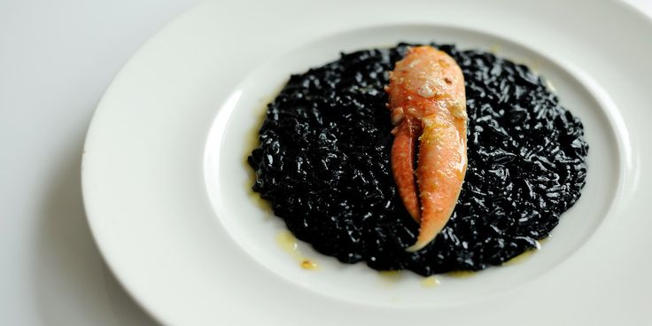 A risotto recipe receives a dramatic update with the introduction of squid ink. Combined with lobster claw, this risotto makes a bold statement on any table.