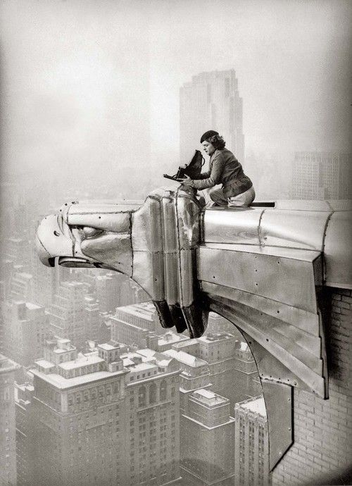 Just a little crazy!: Margaret Bourke-White working at the top of the Chrysler Building, New York, New York, 1935.