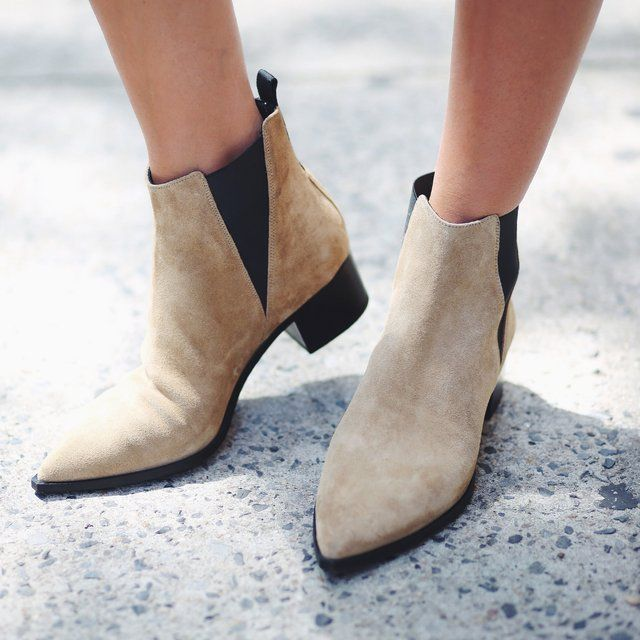 The Acne Studios Jensen boot in a suede beige is a pointed Chelsea boot with angular shaped contrasting elastic. Pointed toe. Angular shaped contrasting elastic. Acne logo tape at back loop. Leather sole. 100% Lamb Leather. Please allow 1-2 weeks for shipping.