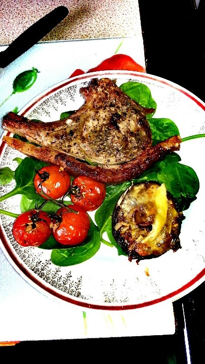 Pork chop, grilled garlic encrusted tomatoes and cheesy mushroom