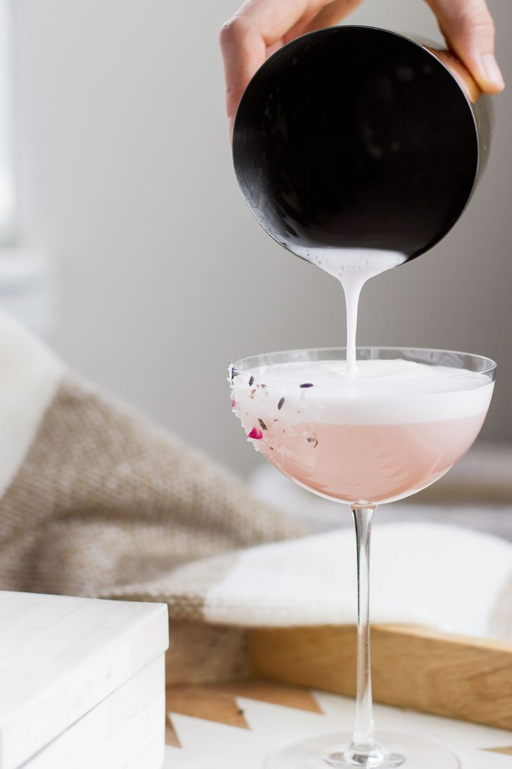 Garden Party Cocktail: A floral fizz with rose water, lavender infused vodka, hibiscus syrup and elderflower liqueur!