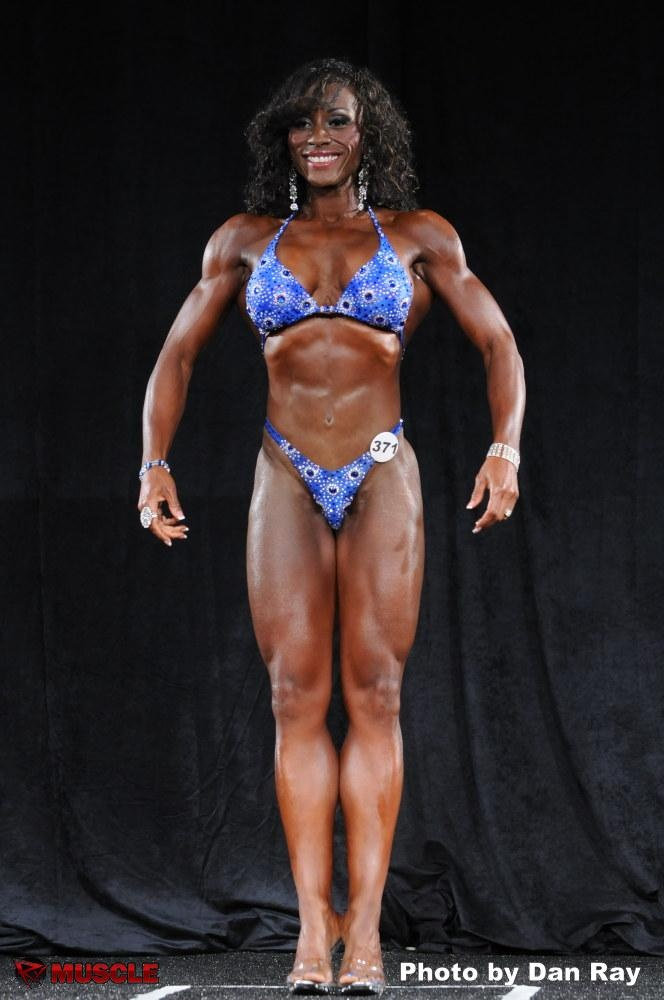 iResolve Fitness Trainer Linda Andrew earns her earning her IFBB Pro Card.