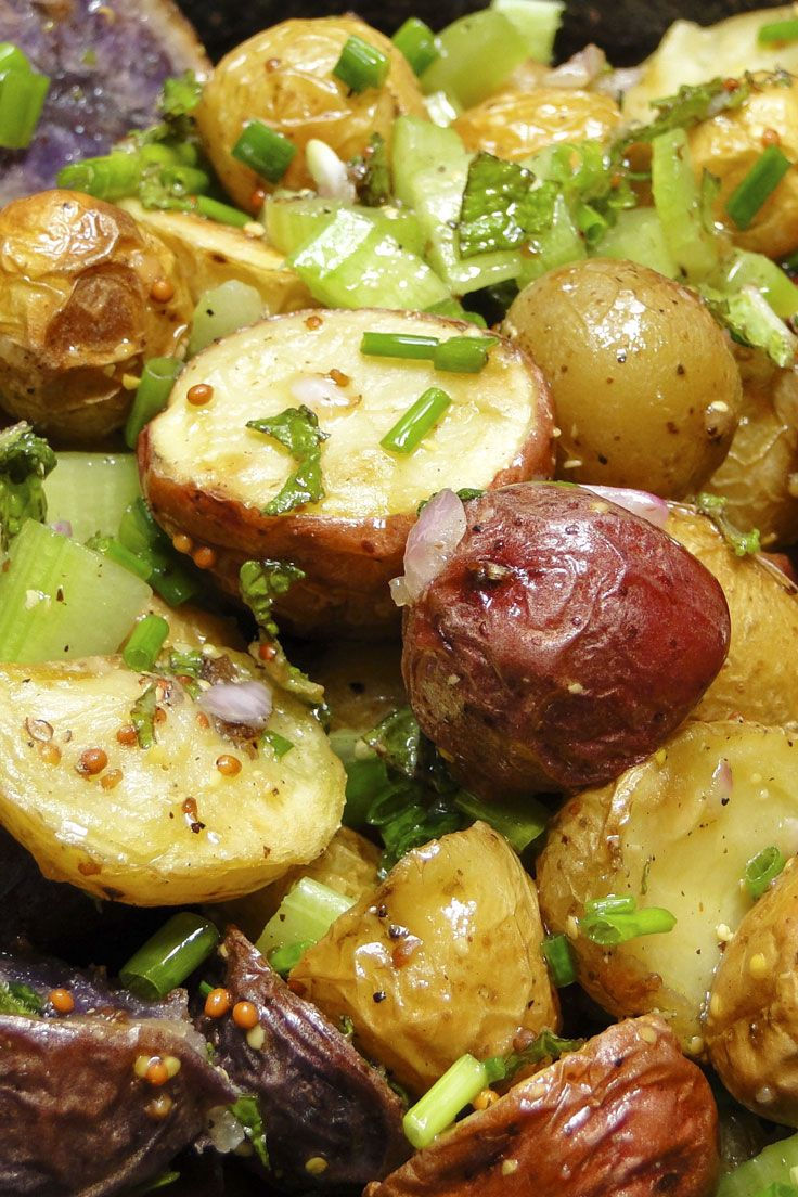 An updated potato salad, minus the mayo, is made with roasted Melissa's red, white and purple baby potatoes, fresh herbs and a mustardy olive oil dressing.