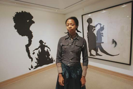 Kara Walker (born 1969) is a contemporary African American artist who explores race, gender, sexuality, violence and identity in her work. She is best known for her room-size tableaux of black cut-paper silhouettes, such as The Means to an End--A Shadow Drama in Five Acts.  In 2007, Walker was listed among Time Magazine's 100 Most Influential People in The World, Artists and Entertainers.   http://www.pbs.org/art21/artists/kara-walker?gclid=CN-xp4CNta8CFQIBQAod1jsRgQ
