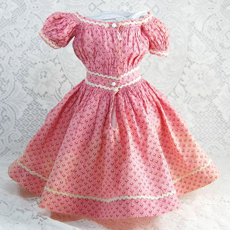 Antique pink calico china doll dress entirely handsewn with cartridge pleats at the waist and off the shoulder styling. It closes at the back with