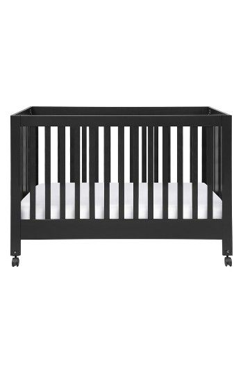 Free shipping and returns on Babyletto Maki Full Size Folding Crib at Nordstrom.com. Clean design blends with contemporary convenience on this full-size foldaway crib that meets baby's changing needs while bringing mid-century modern appeal to your nursery. Crafted from sustainable New Zealand pine wood, this solidly built, eco-friendly crib features all-side slat construction to create an open feel while allowing you to keep an eye on baby from any angle, and two adjustable mattress posi...