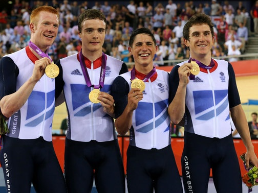 Ed Clancy, Geraint Thomas, Peter Kennaugh and Steven Burke successfully defended Britain's four-kilometre team pursuit title on a night when Victoria Pendleton won keirin gold and the women's team pursuit squad qualified fastest for day three's knockout rounds.