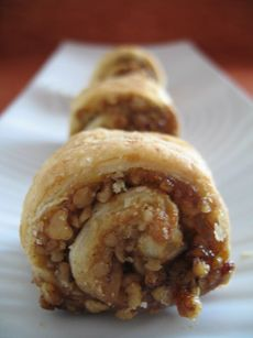 §§§ : Rugelach are often classified as cookies, but they are really miniature pastries: soft dough with filling. Fruit preserves, raisins, nuts, and chocolate are the most popular fillings. There are two basic rugelach shapes: snail, shown in the photo, and horn or crescent. The cream cheese dough is an American invention, as cream cheese did not exist in Europe. The European recipe was made with sour cream. Since rugelach was made in perhaps a dozen European countries by bakers who spoke in…