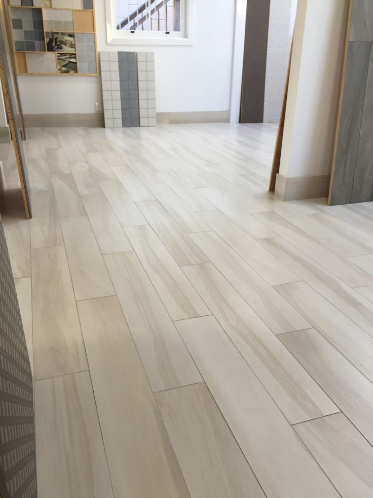 Tabula Blanco by Vallelunga on floor in office/showroom floor in Fortitude Valley. Available in other colours, contact ace for further information. www.acestone.com.au
