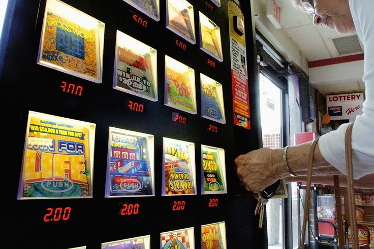 File a woman buys a lottery ticket from a vending
