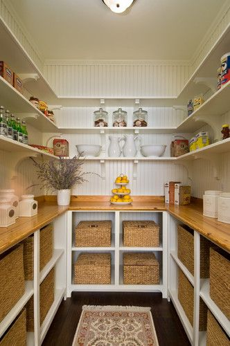 pantry organization .... I would have shelves floor to ceiling on 2 sides andthe counter on one, a great to to keep stuff OFF the kitchen couter!