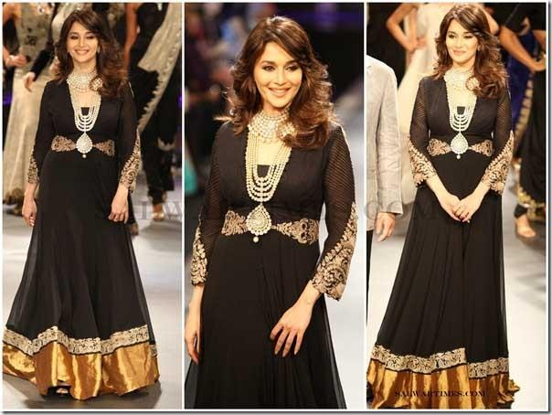 Geogepus black outfit!  Madhuri Dixit wore a black and gold long sleeve dress 18774