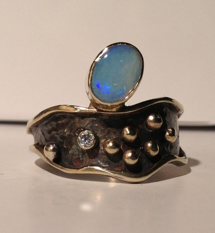 Gold, silver and opal ring