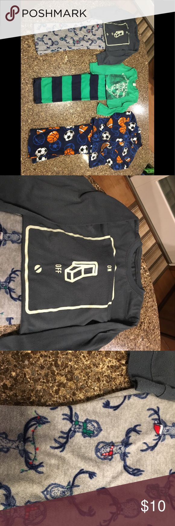 Boys size 6-7 pajama lot! Two GAP, one off brand Boys size 6-7 pajama lot! Two GAP, one off brand!  My guy just grows too quick!   1) Grey on/off switch top with deer fleece bottoms. Top GAP. Bottom GAP Factory. Shirt has piling as typical with this type of fabrication. No stains. EUC otherwise.   2) Green/Blue GAP Factory snowboarder set. Bottoms fleece. Shirt has piling as typical with this type of fabrication. No stains. EUC otherwise.   3) Blue sports set. Jelli Fish kids brand (bought…